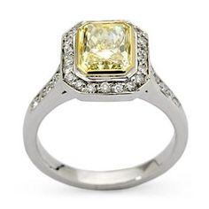 2.00 Carat Fancy Yellow Diamond Ring In Platinum. Size 5