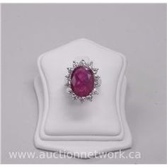 Ladies 18kt White Gold Diamond and Ruby Ring. It Contains 1 Oval Cut Ruby (9.10ct) and 14 Round Bril