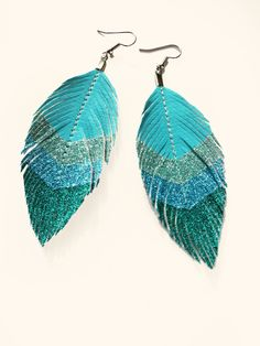 Surf Chevron - Blue Glitter Faux Leather Feather Earrings. $24.80, via Etsy.