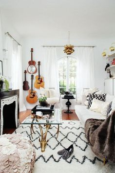 a boho living room accented with guitars on the wall in the corner