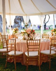 Arrangements of tropical flowers in varying peach and coral tones—including ginger and protea—anchored each table at the reception, which took place at Honua Kai Lani.