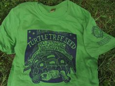 Green. Turtle Tree printed on front, Turtle-Big Dipper-Mississippi logo with poem on left sleeve. Organic cotton from Alternative Apparel. Limited supply!
