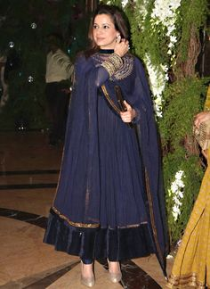 Be Your Own Style Icon With this Neelam Kothari Blue Net Anarkali Suit. Look Ravishing Clad In This Attire Which Is Enhanced Bead, Diamond, Jardosi & Resham Work. Maximum possible bust s...