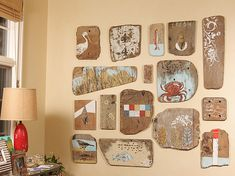 Inspiration for a driftwood wall art gallery!