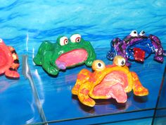 2nd grade pinch pot clay frogs painted with acrylics and glossed with Mod Podge. Art teacher: Susan Joe