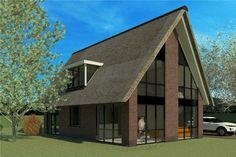 Moderne schuur woning met dak van riet