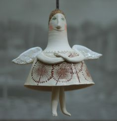 Cute ceramic angel  Bell-doll  Hand made on potter wheel with ceramic transfer using iron oxide.    This kind of bell-dolls i used to make long ago.