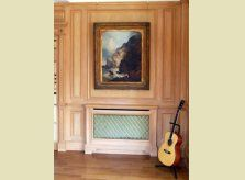 A classic Hallidays hand made pine radiator cover with brass grille