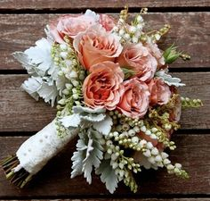 I'm sorry, this is just so pretty. I know you only really like the dusty miller, but hey, im on a roll.... Salmon roses, Dusty Miller, Andromeda.