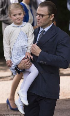 Prince Daniel cradles his daughter Princess Estelle to ensure she doesn't get up to any mischief