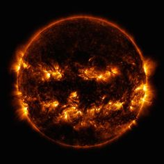 Halloween sun. On October 8, 2014 active regions on the sun gave it the appearance of a jack-o'-lantern. This image is a blend of 171 and 193 angstrom light as captured by the Solar Dynamics Observatory. (NASA/GSFC/SDO)
