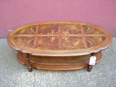 vintage coffee table with inlaid burl veneer & cane shelf. from ReRunRoom