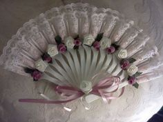 Decorated Fan made out of plastic forks. Cute!
