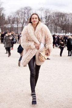 Huge pastel pink fur + leather leggings + studded Alaia boots