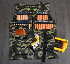 Gummy Bears and Pony Tails: Nerf Gun Vest You are in the right place about Nerf Gun Storage pvc Here Nerf Birthday Party, Nerf Party, Boy Birthday, Nerf Vest, Nerf Gun Storage, Cool Nerf Guns, Nerf Toys, Look T Shirt, Gummy Bears