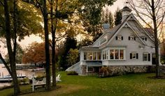 love the upstairs windows facing the lake; great idea for S.L. cabin....  Cottage TMS Architects New England Design