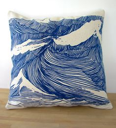 A pillow printed with crashing waves adds a seafaring touch to any space. #NauticalJuly