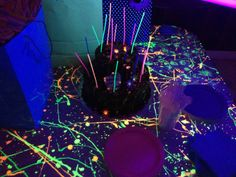 Glow in the dark party: splatter paint on black paper or table cloths