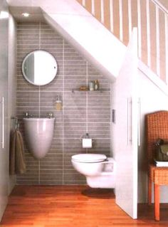 This is just about the best idea in terms of utilising that wasted space under the staircase!  Turn it into a powder room.  Love this!!