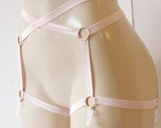 Browse unique items from EmilyJohnstonDesigns on Etsy, a global marketplace of handmade, vintage and creative goods.  Body Harness, Body Cage, Bondage Lingerie, Strappy Lingerie, Pink Lingerie, Garter Belt, Suspender Belt, Garter Clips, Garters, Pink Body Harness, Pink Body Cage, PInk Garter Belt, Pink Suspender Belt, Pink Cage, Pink Harness, Pink Garters, Pink Garter Clips, Gold Rings, Pink Strappy Lingerie, Wedding Lingerie, Sexy Pink Lingerie