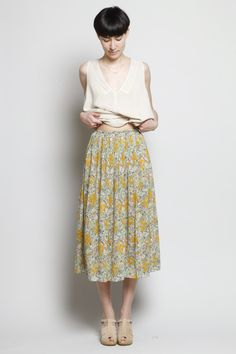 Floral printed full silk crepe de chine skirt with elastic waistband. Pleats stitched at waistband. Slips on. Dry clean.