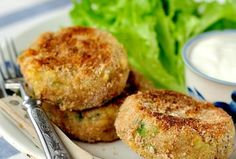 """""""Fish hamburgers"""" with a twist: baked instead of fried! The health benefits of the omega-3s in the salmon and polyphenols in the seasonings are elegantly presented in this delectable combination of classic tastes."""