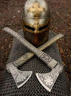 Two ancient axes and a helm discovered in Orgrirholmic ruins. Runes indicate that these belonged to the demigod Aldvif Gaedison. Espada Viking, Arte Ninja, Viking Axe, Viking Sword, Viking Helmet, Battle Axe, Medieval Weapons, Arm Armor, Fantasy Weapons