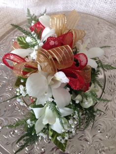 White Dendrobium orchid corsage with a red and gold bow White Dendrobium Orchids, Orchid Corsages, Homecoming Flowers, Flower Cart, Prom 2016, Boutonnieres, Christmas Wreaths, Bow, Table Decorations