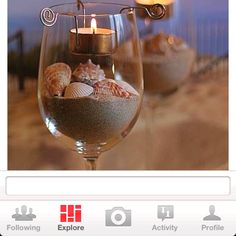 Beach wedding decor. Seashells and sand in wine glasses! With candles. Cute! @Kristin