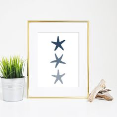 This navy blue starfish trio wall art print is a great way to add a nautical or beach vibe to your home or nursery in a snap. The minimalist print is perfect for a simple nursery decor or coastal home