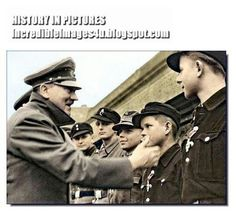 Here Hitler is seen with 16 years old (he looks younger) Willi Huebner who was awarded the Iron Cross, Second Class, for his services in the recapture of Lauban in March 1945. The boy was a messenger and distinguished himself with his service.