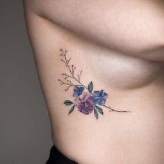 28 Gorgeous Wildflower Tattoos For Free Spirits Wildflower Tattoo Ideas Violet Flower Tattoos, Violet Tattoo, Birth Flower Tattoos, Butterfly Tattoos, Piercing Tattoo, Piercings, Form Tattoo, Shape Tattoo, Body Art Tattoos