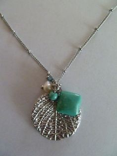 Lia Sophia: filigree poplar leaf accented with genuine turquoise, freshwater pearl and glass bead.