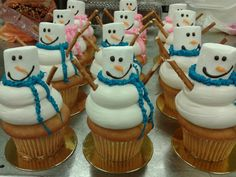 Snowman Cupcakes! Colored frostings, Pretzel Sticks, Marshmallow, melted chocolate wafers (for eyes and mouth).