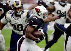 Rams vs. Cardinals Updated October 2, 2016:  17-13, Rams  -     Arizona Cardinals running back David Johnson (31) runs as Los Angeles Rams defensive tackle Aaron Donald (99) pursues during the first half of an NFL football game, Sunday, Oct. 2, 2016, in Glendale, Ariz.