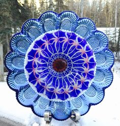 Beautiful Vintage Glass Plate Sun-catcher.   All my art is created with vintage plates and bowls that I have gathered from such names as Fenton, Fire King and Indiana Glass to name a few.  This yard art is so beautiful that you are sure to make all your neighbors jealous!    My Suncatchers have a round elastic rubber disc with a pre-drilled hole that is attached to the back. All you need for set-up is to insert a rebar or copper pole into the pre drilled hole. This listing does not include…