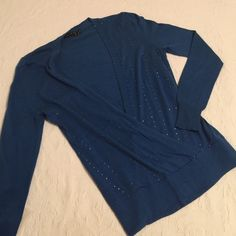 Sweater The Limited blue Wrap front dark blue sweater that is lightweight has beautiful tiny lines of rhinestones on the front.  Perfect for daily wear or dress it up for the holidays.  The Limited Sweaters V-Necks