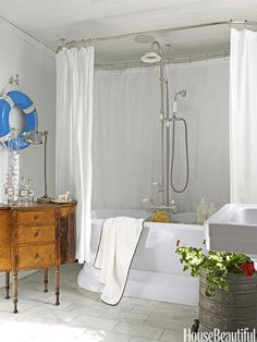 """Put an Antique in the Bathroom - The guest bath in Fulk's vacation home """"feels authentic to the period of the house, but also clean and modern,"""" he says. Pedestal tub and fixtures from Sunrise Specialty."""