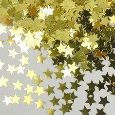 Confeti de plástico con forma de estrellas, para adornar la mesa, los regalos, las invitaciones... De www.fiestafacil.com, $2.40 / Gold plastic star-shaped confetti, to decorate the table, the gifts, the invitations... From www.fiestafacil.com