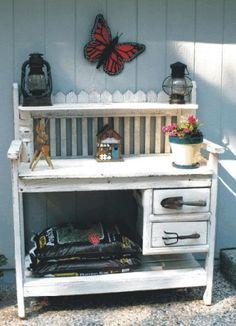 Potting Table with drawers.  This actually looks like a modified baby's changing table -- gives me inspiration!