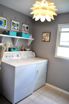gray laundry rooms Laundry room - love the light fixture and grey walls Blue Laundry Rooms, Laundry Room Shelves, Laundry Room Remodel, Laundry Closet, Laundry Area, Mud Rooms, Small Laundry, Bathroom Floor Tiles, Bathroom Fixtures