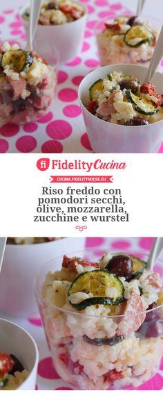 Riso freddo con pomodori secchi, olive, mozzarella, zucchine e wurstel