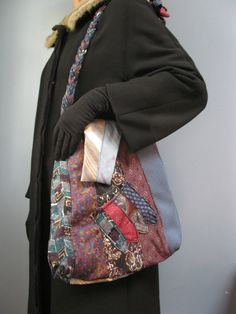 Using mens neckties she has crafted a shoulder tote with a very comfortable,