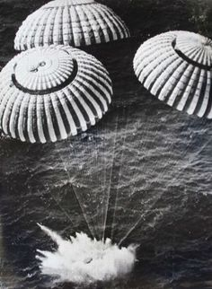 """Apollo 11 splashes down in the Pacific Ocean on July 24, 1969 after orbiting the moon. Writes Sweet: """"NASA didn't want the press too close to the splashdown site, in case they opened the capsule door and found the men dead."""" Sweet had to stay on a nearby Navy ship, so he gave cameras to a military helicopter crew picking up the astronauts, asked them to take pictures, and promised that they could keep the cameras afterward. That's how Sweet got his famous splashdown pictures. Photo: Barry R…"""