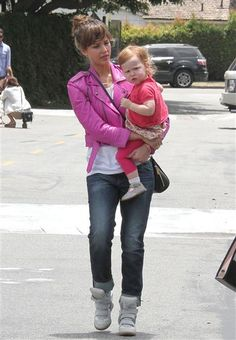 Jessica Alba donned her new favorite accessory -- her hot pink leather jacket -- while toting daughter Haven in Los Angeles on June 9, 2013.
