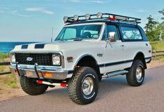 """1972 Blazer With Safari Rack & Baja Lights, Even though they all came with Full Removable/Convertible Tops/Roofs they Never Came Shiny Black from the factory but With the lower trim moulding & the Rally Stripes This Is Real Nice!! It Looks """"Right"""" Like Mine hahaha!!"""