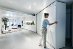 A Small Studio Morphs Into a Two-Bedroom Apartment Within Seconds: Many of the essential elements required for modern living, such as desks and tables, are tucked into the large, moveable walls. 9 Apartments With Clever Clutter-Busting Cabinets Horizontal Murphy Bed, Moving Walls, Movable Walls, Transforming Furniture, Two Bedroom Apartments, Tiny House Movement, Module, Small Studio, Built In Storage