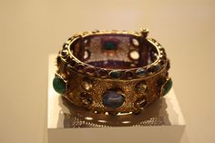 Gold, glass, and precious stones (emeralds, sapphires, garnets), ca. 370-400 C.E.  Found together with the preceding coin belt and bracelet.  From the collection of the Getty Villa, Malibu, California.