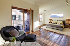 Very nice interior of green house built with many local and recycled materials. The Greenest Home on the Block,Courtesy of Caron Architecture