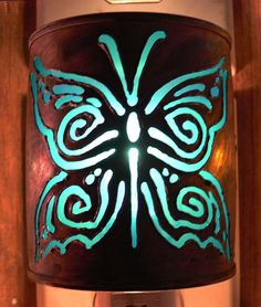 Hey, I found this really awesome Etsy listing at http://www.etsy.com/listing/87877430/butterfly-night-light-recycled-tin-can